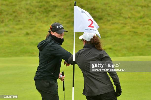 Emily Toy of England elbow bumps with Chloe Goadby of Scotland after her victory during Round 3 of Matchplay on Day Four of The Women's Amateur...