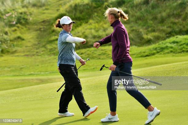 Emily Toy of England elbow bumps with Gile Bite Starkute of Lithuania following her victory during the Quarter Finals on Day Four of The Women's...