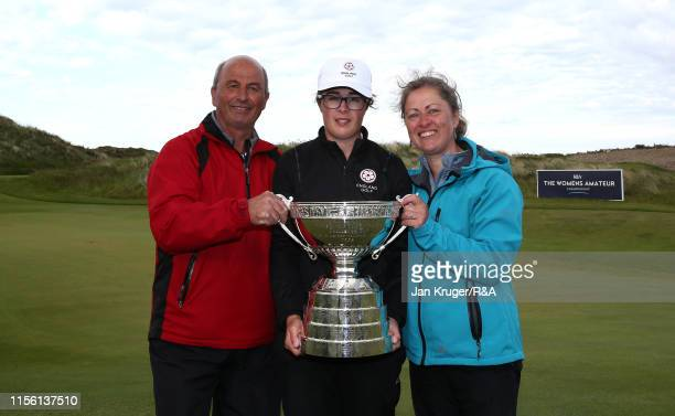 Emily Toy of England poses with the trophy and her parents following victory during the final match on day five of the RA Womens Amateur Championship...
