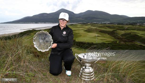 Emily Toy of England poses with the trophy following victory during the final match on day five of the RA Womens Amateur Championship at Royal County...