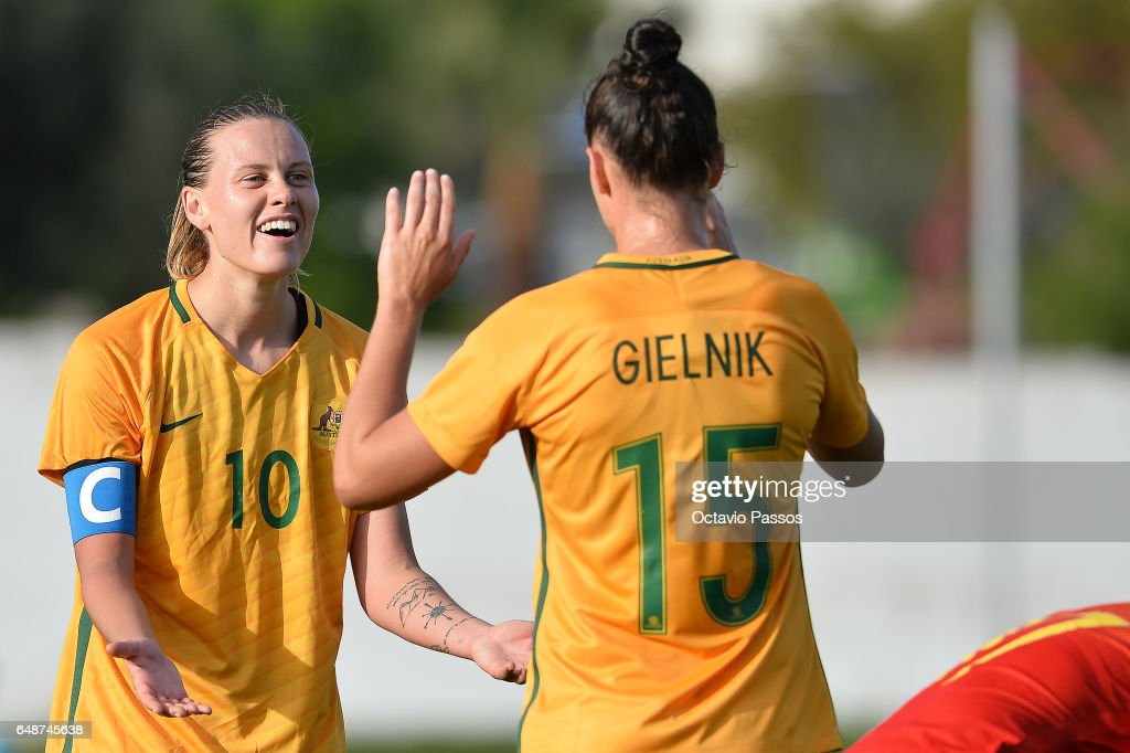 Emily Van Egmond (L) and Emily Gielnik of Australia celebrates the victory at the end of the Women's Algarve Cup Tournament match between China and Australia at Municipal de Albufeira on March 6, 2017 in Albufeira, Portugal.