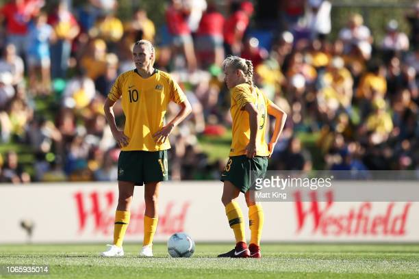 Emily van Egmond and Tameka Butt of Australia look dejected after the final Chile goal during the International Friendly match between the Australian...