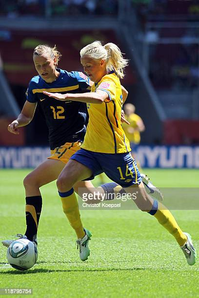 Emily van Egmond of Australia and Josefine Oqvist of Sweden fight for the ball during the FIFA Women's World Cup 2011 Quarter Final match between...
