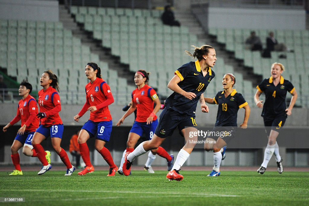 Emily van Egmond (3rd R) of Australia celebrates scoring her team's second goal during the AFC Women's Olympic Final Qualification Round match between South Korea and Australia at Yanmar Stadium Nagai on March 4, 2016 in Osaka, Japan.
