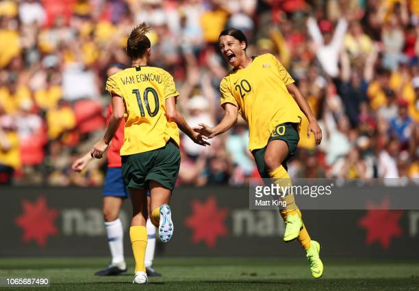 Emily van Egmond of Australia celebrates with Samantha Kerr after scoring a goal during the International Friendly match between the Australian...