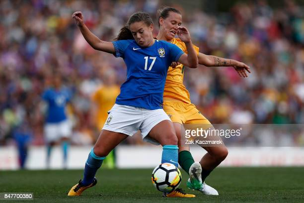 Emily Van Egmond of Australia challenges Andressa Cavalari Machry of Brazil during the women's international match between the Australian Matildas...