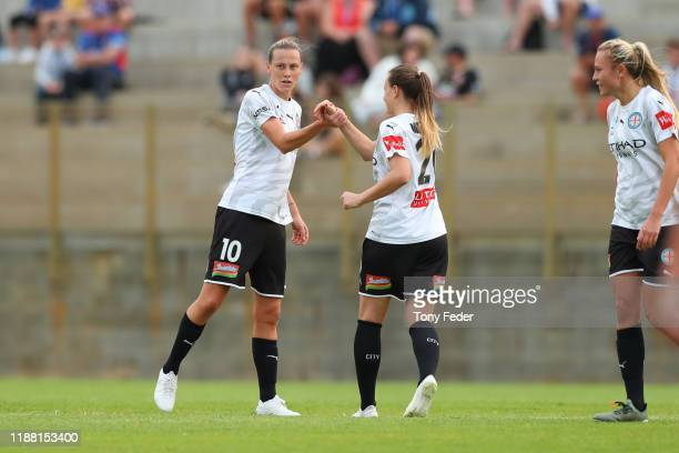 Emily Van Egmond of Melbourne City celebrates a goal with a team mate during the round 1 WLeague match between the Newcastle Jets and Melbourne City...