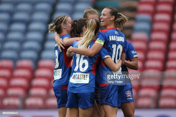 Emily Van Egmond of the Jets celebrates a goal with team mates during the round two WLeague match between the Newcastle Jets and Sydney FC at...