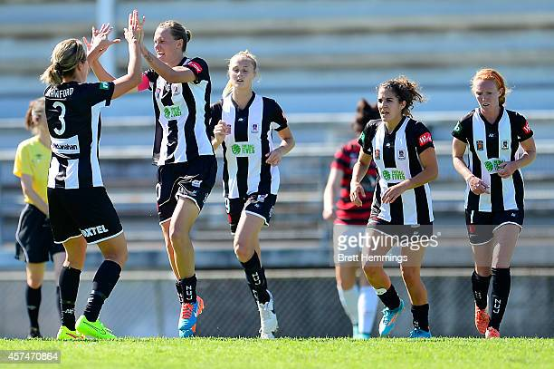 Emily Van Egmond of the Jets celebrates with his team mates after scoring during the round six WLeague match between the Western Sydney Wanderers and...