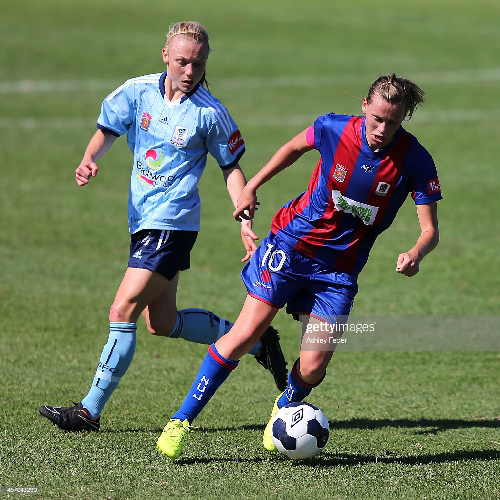 Emily Van Egmond of the Jets controls the ball ahead of Teigen Allen of Sydney FC during the round five W-League match between the Newcastle Jets and Sydney FC at Magic Park on October 11, 2014 in Newcastle, Australia.