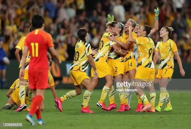 Emily van Egmond of the Matildas celebrates scoring a goal with team mates during the Women's Olympic Football Tournament Qualifier between Australia...
