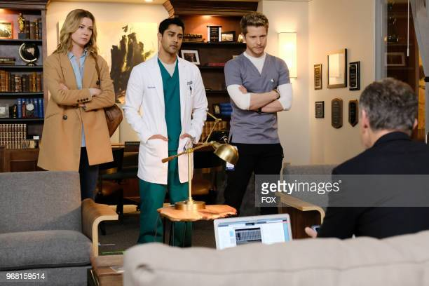 Emily VanCamp Manish Dayal and Matt Czuchry in the 'Total Eclipse of the Heart' season finale episode of THE RESIDENT airing Monday May 14 on FOX