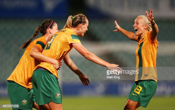 Emily VanEgmond of the Matildas celebrates with Laura Alleway and Tameka Butt after scoring the second goal during the Women's International Friendly...