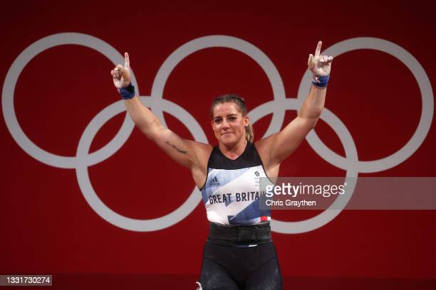 Emily Victoria Godley of Team Great Britain competes during the Weightlifting - Women's 76kg Group B on day nine of the Tokyo 2020 Olympic Games at...