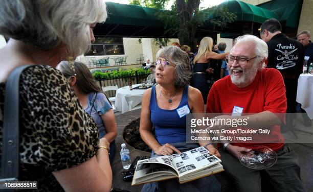 Emily Vila Haack, from left, points out herself in the Boulder High School 1969 yearbook to Berniece Baker and Dave Anderson at the BHS class of 1969...