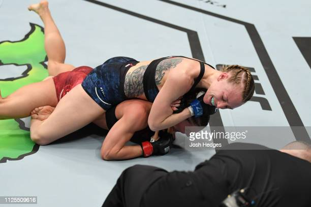 Emily Whitmire attempts to submit Alexandra Albu of Moldova in their women's strawweight bout during the UFC Fight Night event at Talking Stick...
