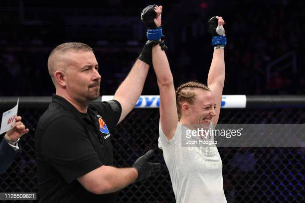 Emily Whitmire celebrates her submission victory over Alexandra Albu of Moldova in their women's strawweight bout during the UFC Fight Night event at...