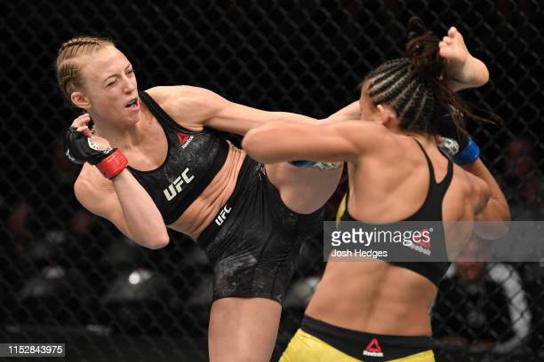 Emily Whitmire kicks Amanda Ribas of Brazil in their women's strawweight bout during the UFC Fight Night event at the Target Center on June 29 2019...