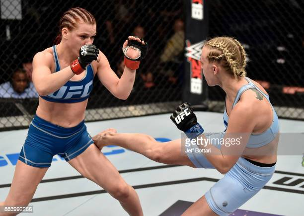 Emily Whitmire kicks Gillian Robertson of Canada in their women's flyweight bout during the TUF Finale event inside Park Theater on December 01 2017...