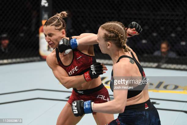 Emily Whitmire punches Alexandra Albu of Moldova in their women's strawweight bout during the UFC Fight Night event at Talking Stick Resort Arena on...