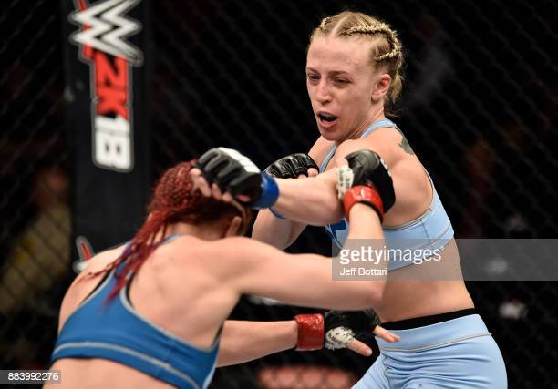 Emily Whitmire punches Gillian Robertson of Canada in their women's flyweight bout during the TUF Finale event inside Park Theater on December 01...