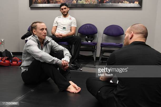Emily Whitmire rests backstage during the UFC Fight Night event at Talking Stick Resort Arena on February 17 2019 in Phoenix Arizona