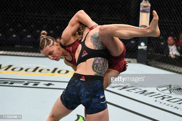 Emily Whitmire takes down Alexandra Albu of Moldova in their women's strawweight bout during the UFC Fight Night event at Talking Stick Resort Arena...