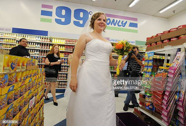 Emily Wiley waits amongst the food aisles before her 99 cent wedding ceremony at the 99 cent store in Los Angeles on September 9 2009 The budget...