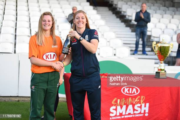Emily Windsor of Hursley Park is awarded man of the match by Heather Knight of England after winning the Kia Final match between Sessay and Hursley...
