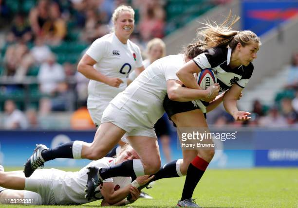 Emily Wood of Barbarians breaks with the ball to score her team's first try during the England Women v Barbarians Women match at Twickenham Stadium...