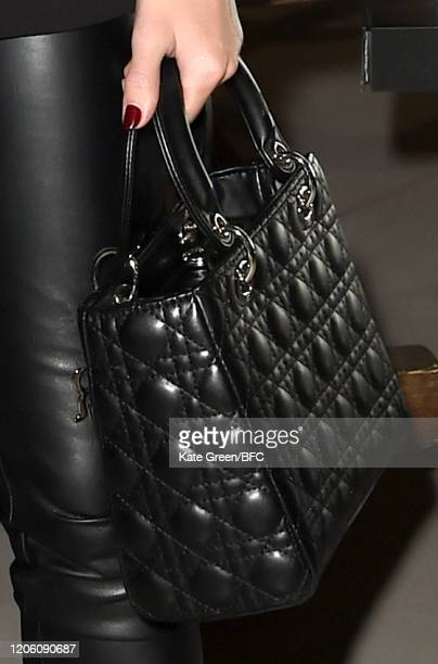 Emily Wright bag detail attends the Wolf Badger 10th Year Anniversary party during London Fashion Week February 2020 at Coal Drops Yard on February...