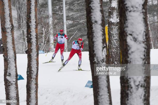 TOPSHOT Emily Young of Canada and compatriot Brittany Hudak compete in the women's 125km standing biathlon event at the Alpensia Biathlon Centre...