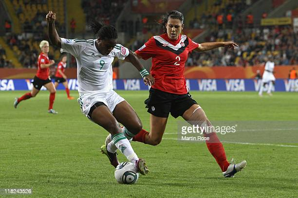 Emily Zurrer of Canada and Desire Oparanozie of Nigeria battle for the ball during the FIFA Women's World Cup 2011 Group A match between Canada and...