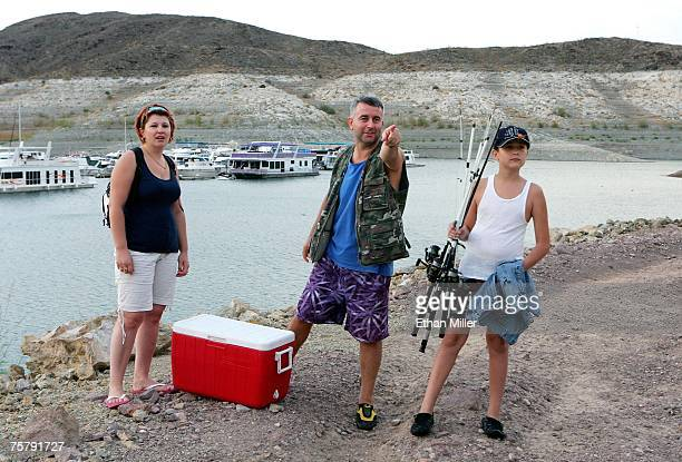 Emin Zahirovic of Nevada points out a rabbit running in the brush to his wife Sabiha Zahirovic and their son Muharem Zahirovic as they wrap up a day...