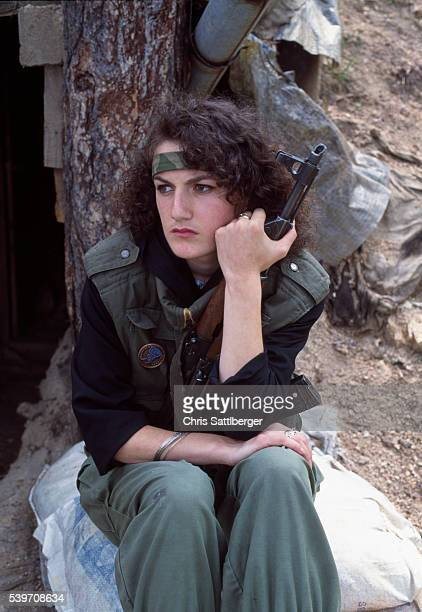 Emina Bakic joined the Bosnian army at the age of 18 after her father died Emina carrying a gun | Location TREBEVIC Bosnia and Herzegovina