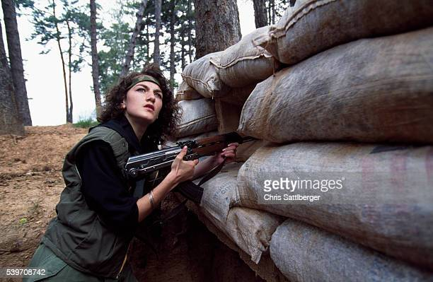Emina Bakic joined the Bosnian army at the age of 18 after her father died Emina in her army fatigues | Location TREBEVIC Bosnia and Herzegovina