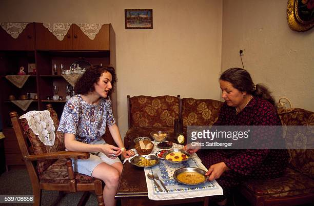 Emina Bakic who joined the Bosnian army at 18 after her father's death shares a meal with her mother Zulifina