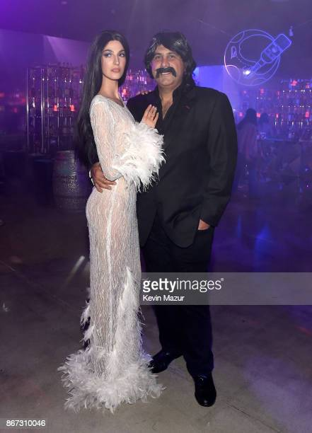 Emina Cunmulaj and Sam Nazarian attend Casamigos Halloween Party on October 27 2017 in Los Angeles California