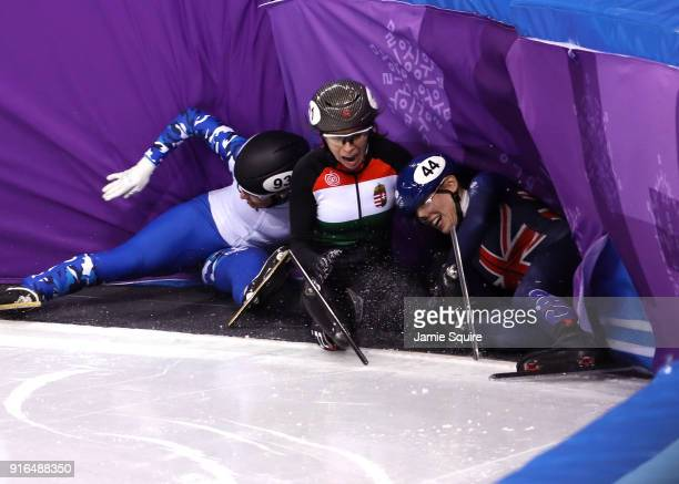Emina Malagich of Olympic Athlete from Russia, Petra Jaszapati of Hungary and Charlotte Gilmartin of Great Britain crash during the Ladies' 500m...