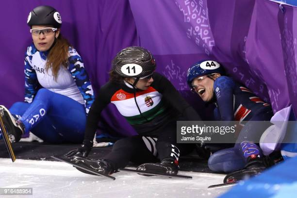 Emina Malagich of Olympic Athlete from Russia Petra Jaszapati of Hungary and Charlotte Gilmartin of Great Britain crash during the Ladies' 500m Short...