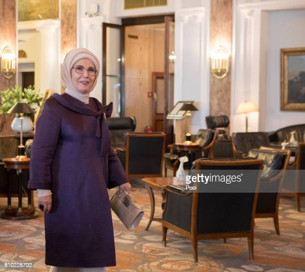 Emine Erdogan wife of Recep Tayyip Erdogan President of the Republic of Turkey walks through the lobby of the Atlantic Hotel as she takes part in the...