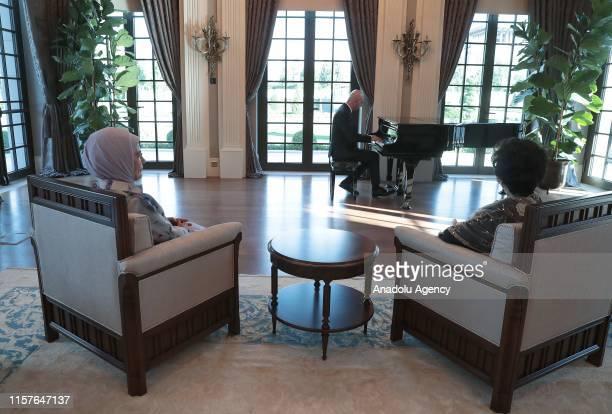 Emine Erdogan wife of Turkish President Recep Tayyip Erdogan meets Siti Hasmah Mohamad Ali wife Malaysian Prime Minister Mahathir Mohamad listening...