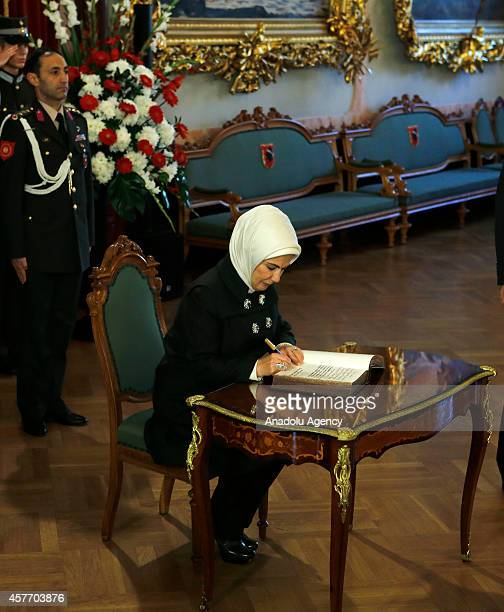 Emine Erdogan wife of Turkish President Recep Tayyip Erdogan writes in the visitor's book ahead of a meeting at House of the Blackheads in Riga...