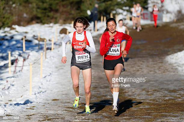 Emine Hatun Tuna of Turkey and Alina Reh of Germany lead the Junior Women's Race during the European CrossCountry Championships on December 14 2014...