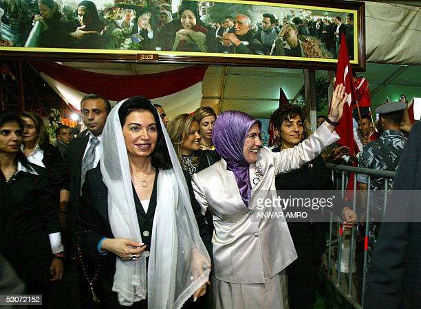 Emine the wife of Turkish Prime Minister Recep Tayyip Erdogan waves to Turkish people after she visited with Nazik Hariri the widow of Lebanon's...