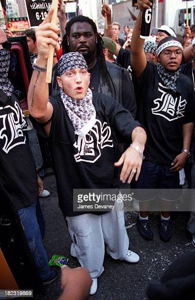 Eminem and Member of D12 during Eminem Marches in Times Square to Promote his New Group D12 at Times Square in New York City New York United States