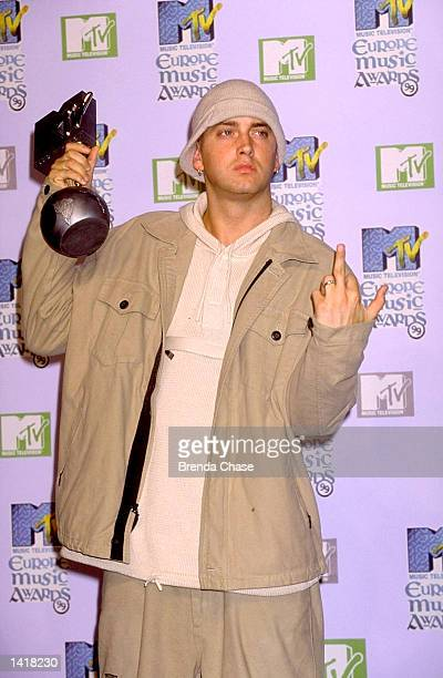Eminem gestures at photographers at the 1999 MTV Europe Music Awards November 12 1999 in Dublin Ireland