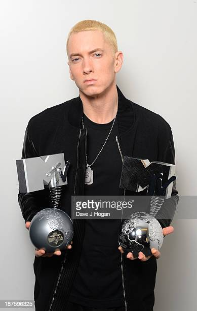 Eminem poses in his dressing room with the 'Best Hip Hop' and 'Global Icon' awards during the MTV EMA's 2013 at the Ziggo Dome on November 10 2013 in...