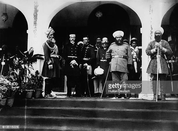 Emir Abdor Rahman Khan standing with a foreign secretary at Rawalpindi.