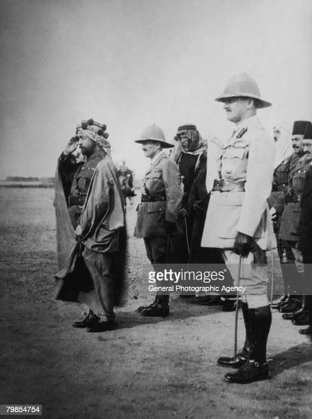 Emir Abdullah ibn Hussein of Transjordan with Lord Allenby and T E Lawrence attend a military review during the Arab Revolt circa 1917